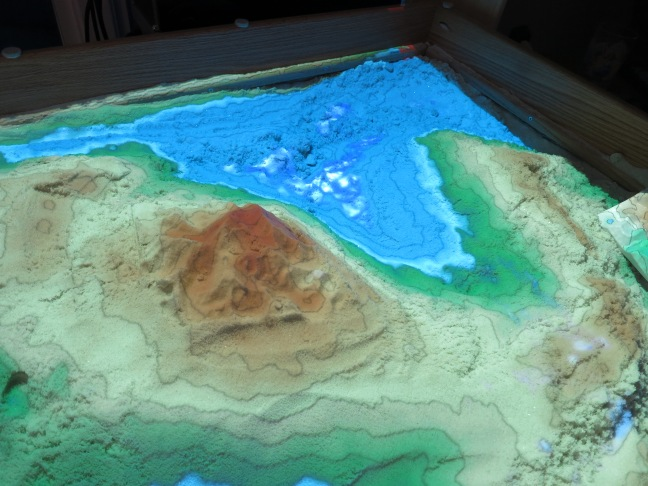 An interactive sand table that uses the Xbox camera to create contoured surfaces